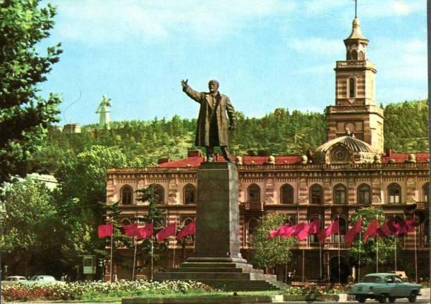 Lenin monument at the former Lenin square and nowadays Freedom Square with St. George Statue