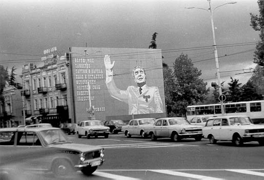 Brezhnev waving from a building next to the Tbilisi Philharmonic